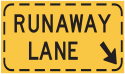 Runaway Lane signs are found on steep downgrades and provide a means of stopping a heavy vehicle that has lost its brakes.