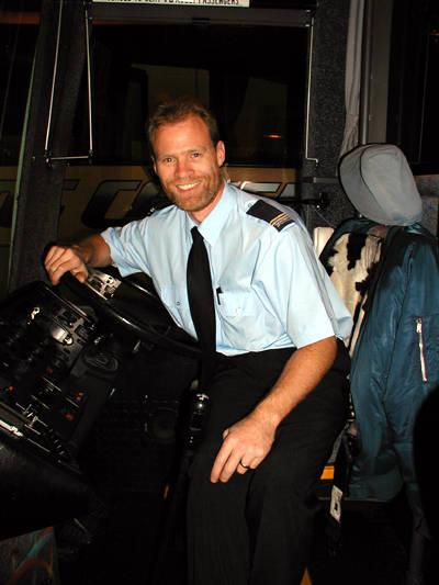 Rick August working as an Australian Greyhound Coach Captain in 2002.