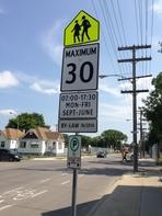 In many school zone areas, school zone signs will designate the time and days that speed limits are in effect for drivers.