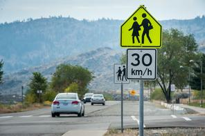 This school zone sign is a regulartory sign and driver must reduce speed to 30kph. In the United States driver my drive 20mph. During school days you must drive this speed between 8am & 5pm.