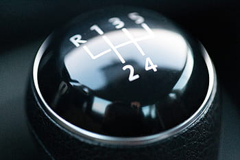 To select reverse in this car, it is over to the left and up. Some times there is a locking ring on the selector that has to be pulled up so it will go into reverse gear.