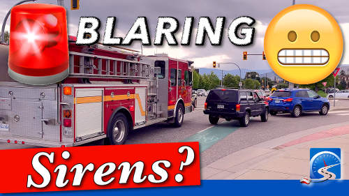 For the purposes of a driver's test you must pull over and come to a stop immediately for an emergency vehicle.