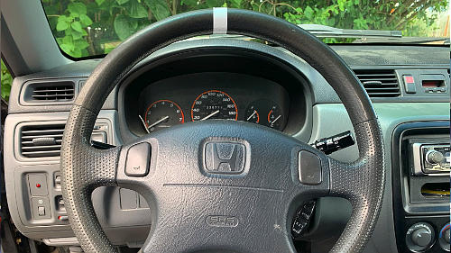Put a piece of tape on the top of your steering wheel to know where your steer tires are at a glance.