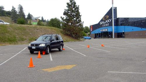 Hitting the cones is not a bad thing. It teaches you where your vehicle is in relation to other objects on the road.