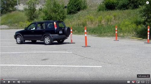 After practicing for a bit getting the vehicle between the cones, back from the passenger side to improve your skills.