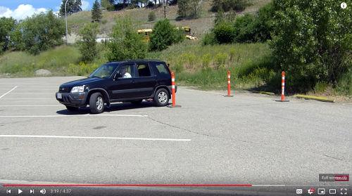 When beginning to park between the cones, start by reversing from the drivers side - it's easier to see.