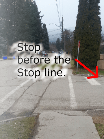 On a road test, you MUST stop at the correct stopping position at controlled intersections: before STOP line; before crosswalk lines or sidewalk; at the edge where two roads meet.