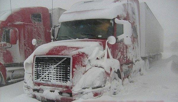 Truck drivers waiting out the winter storm in safe location. Learn smart winter driving techniques with this course.